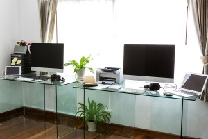 Modern home office with computer and labtop