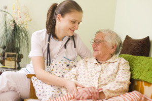 Helping A Sick Elderly Woman