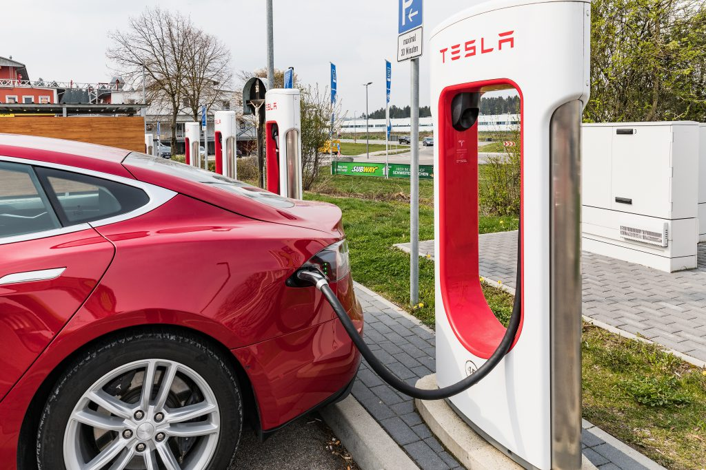 Euro Rastpark Pfaffenhofen, GERMANY - April 9, 2019 Charging TESLA cars at the charging station. Tesla Moles S 70D, Tesla supercharge station with a car on charging. Stockfoto-ID: 297106498 Copyright: Nadege, Bigstockphoto.com